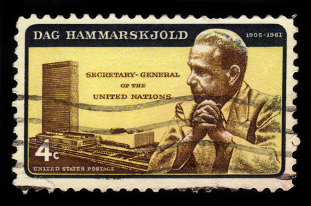 united nations: UNITED STATES OF AMERICA - CIRCA 1962: a stamp printed in the USA shows UN Headquarters and portrait of Dag Hammarskjold, second secretary-general of the United Nations, circa 1962 Editorial