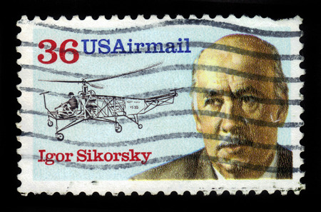igor: UNITED STATES OF AMERICA - CIRCA 1988: a stamp printed in USA shows Igor Sikorsky 1889-1972 and helicopter vought-sikorsky VS-300 of 1939, aeronautic engineer, series aviation pioneer, circa 1988 Editorial