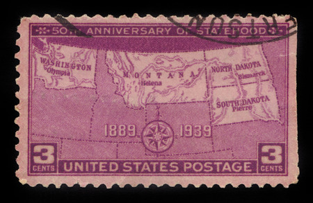 50th: UNITED STATES OF AMERICA - CIRCA 1939: a stamp printed in the USA shows map of North and South Dakota, Montana and Washington, dedicated to the 50th anniversary of the statehood, circa 1939 Editorial