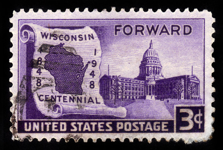 statehood: UNITED STATES OF AMERICA - CIRCA 1948: a stamp printed in USA shows map of Wisconsin on scroll and State Capital, Wisconsin Statehood, 100th anniversary, circa 1948
