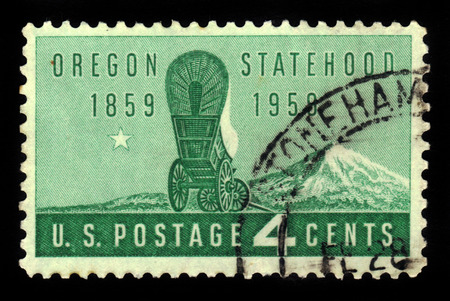 statehood: UNITED STATES OF AMERICA - CIRCA 1959: a stamp printed in the USA shows covered wagon and Mount Hood, Oregon statehood , centenary, circa 1959