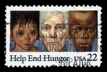 hunger: UNITED STATES OF AMERICA - CIRCA 1985: a stamp printed in USA shows youths and elderly suffering from malnutrition, with an inscription help end hunger, circa 1985