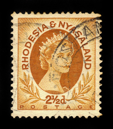 queen elizabeth: RHODESIA AND NYASALAND - CIRCA 1954: A stamp printed in Federation of Rhodesia and Nyasaland, also known as the Central African Federation CAF shows Queen Elizabeth II, circa 1954
