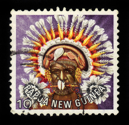 feathered: PAPUA NEW GUINEA - CIRCA 1978: stamp printed in Papua New Guinea shows a man in a feathered headdress from the Central Province, circa 1978