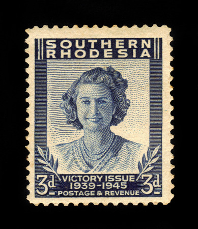dominions: SOUTHERN RHODESIA - CIRCA 1946: A stamp printed in United Kingdom shows Princess Elizabeth, Victory Peace issue, the end of World War II, circa 1946 Editorial