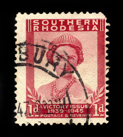 queen elizabeth: SOUTHERN RHODESIA - CIRCA 1946: A stamp printed in United Kingdom shows Queen Elizabeth The Queen Mother, Victory Peace issue, the end of World War II, circa 1946