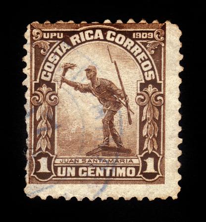 national hero: COSTA RICA - CIRCA 1910: a stamp printed in Costa Rica shows Juan Santamaria monument, national hero of the Republic of Costa Rica, circa 1910 Editorial