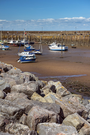 mousehole: fishing boats at low tide, Penzance harbour, Cornwall, England