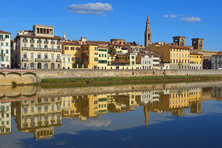 historical reflections: reflection of the old florentine houses in the waters of the Arno River, Florence, Italy