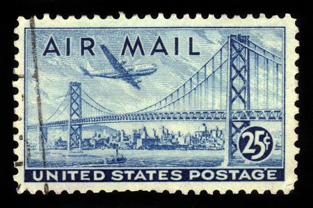 oakland: USA - CIRCA 1947: A stamp printed in USA shows San Francisco, Oakland Bay Bridge and Boeing B377 Stratocruiser, circa 1947