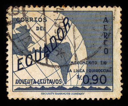 equator: Ecuador - CIRCA 1953: A stamp printed in Ecuador shows globe with equator, Ecuador, inscription monument on the line equator, circa 1953;