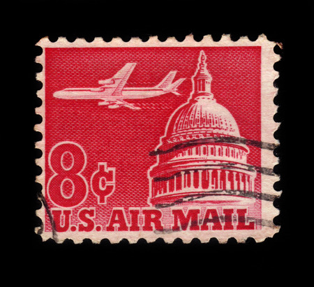 jetliner: USA - CIRCA 1962: A stamp printed in USA shows jetliner over the US Capitol, circa 1962; Editorial