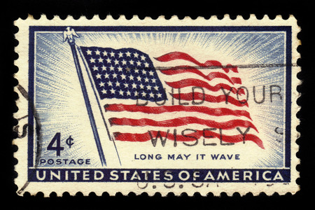 USA - CIRCA 1957: a stamp printed in USA shows flag of the United States, Old Glory (48 stars), inscription long may it wave, circa 1957 Editöryel