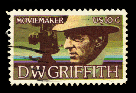 motion picture: USA - CIRCA 1975: a stamp printed in the USA, shows David Wark Griffith (1875-1948), Motion Picture Producer, circa 1975;