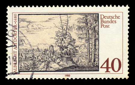 engraver: GERMANY - CIRCA 1980: a stamp printed in Germany shows landscape with fir trees by Albrecht Altdorfer, german painter and engraver, circa 1980