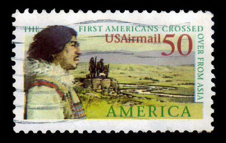 columbian: USA - CIRCA 1991: a stamp printed in USA shows landscape with the first american crossed over from asia, circa 1991