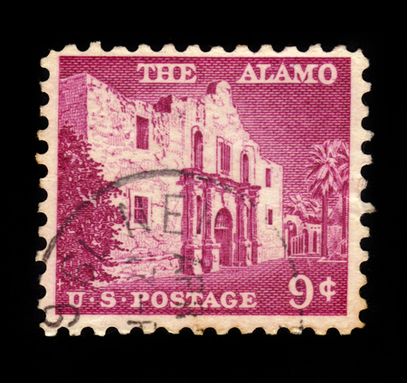 pivotal: UNITED STATES OF AMERICA - CIRCA 1956: a stamp printed in the United States of America shows The Alamo mission, the place of pivotal event in the Texas Revolution in 1836, circa 1956 Editorial