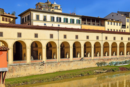 historical reflections: embankment of the Arno River near the Ponte Vecchio and Uffizi Gallery, Florence, Italy Stock Photo