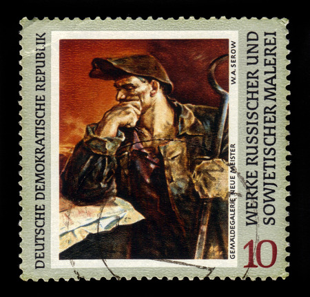steelmaker: GERMANY - CIRCA 1969: a stamp printed in the Germany, Democratic Republic (DDR) shows painting Steel-worker by Serov, the series Russian Paintings, circa 1969