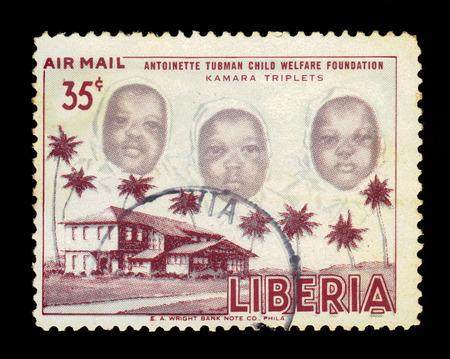 triplet: LIBERIA - CIRCA 1957: stamp printed by Liberia, shows the kamara triplet, with inscription antoinette tubman child welfare foundation, circa 1957