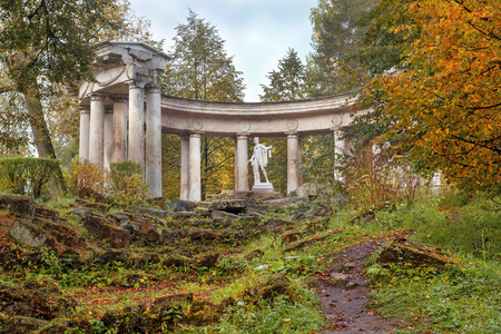 autumn morning, pavilion Apollo Colonnade with statue of Apollo Belvedere - roman marble copy of a bronze original of ancient Greek sculptor Leohara in Pavlovsk Park, Saint Petersburg, Russia