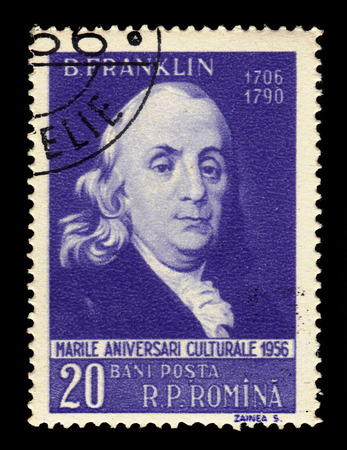 postmaster: ROMANIA - CIRCA 1956: a stamp printed in the Romania shows Benjamin Franklin (1706-1790) american politican, one of the Founding Fathers of the United States, circa 1956