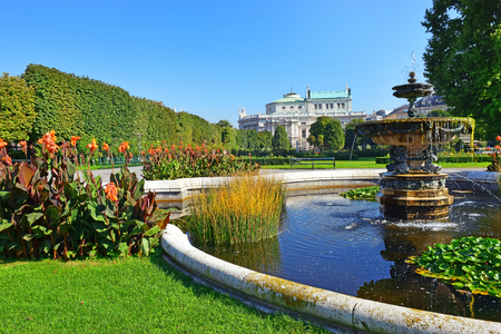 Peoples Garden (Volksgarten, 1821) - public park in Inner Stadt Vienna, Austria. Garden is part of Hofburg Palace, was laid out by Ludwig Remy, Burgtheater in the background