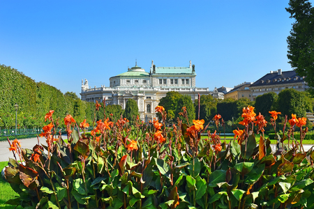 innere: Peoples Garden (Volksgarten, 1821) - public park in Inner Stadt Vienna, Austria. Garden is part of Hofburg Palace, was laid out by Ludwig Remy, Burgtheater in the background