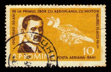 inventor: ROMANIA - CIRCA 1960: A stamp printed in Romania shows portrait of Aurel Vlaicu, romanian engineer, inventor, airplane constructor, early pilot and Vlaicu I airplane, circa 1960