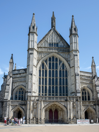 winchester: Winchester, Hampshire, England - August 02, 2015: west facade of Winchester Cathedral on August 02, 2015 Winchester, Hampshire, England Editorial