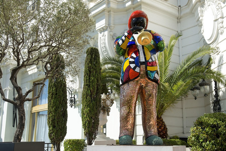 dewey: NICE, FRANCE, French Riviera - March 23: statue of Miles Davis by french artist Niki de Saint Phalle, in front of the hotel Negresco on Promenade des Anglais on March 23, 2014, Nice, France. Miles Dewey Davis III was an american jazz trumpeter Editorial