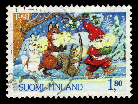 vintage stamp: FINLAND - CIRCA 1991: a stamp printed in Finland shows Santa Claus and animals with candles, series Christmas, circa 1991