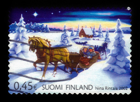 FINLAND - CIRCA 2002: a stamp printed in Finland shows winter sleigh, Christmas in Finland, series christmas, circa 2002 Stok Fotoğraf - 60446251