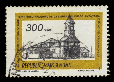 Argentina - CIRCA 1978: A stamp printed in Argentina shows Chapel of Rio Grande Museum, Tierra del Fuego, Argentina, series, circa 1978 Editorial