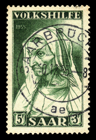 albrecht: Germany, Saarland - CIRCA 1955: a stamp printed in the Saar, Germany shows painting by Albrecht Durer, portrait of the artists mother at the age of 63, circa 1955 Editorial