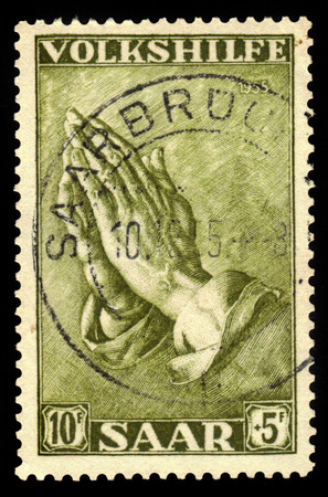 albrecht: Germany, Saarland - CIRCA 1955: a stamp printed in the Saar, Germany shows painting by Albrecht Durer, praying hands, circa 1955 Editorial