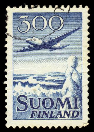 douglas: FINLAND - CIRCA 1950: a stamp printed in Finland shows aircraft Douglas DC-6 over winter landscape, circa 1950