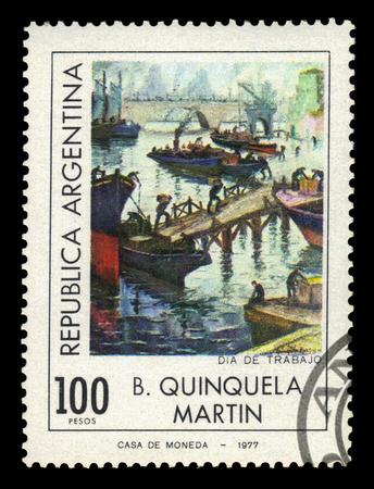 ARGENTINA - CIRCA 1977: a stamp printed in the Argentina shows labor day in port La Boca, painting by Benito Quinquela Martin, argentinean artist, circa 1977 Editorial