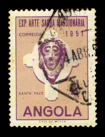 missionary: ANGOLA - CIRCA 1952: A stamp printed in Angola shows a head of Christ, exhibition of sacred missionary art issue, lilac, ochre, circa 1952