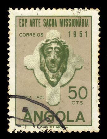 missionary: ANGOLA - CIRCA 1952: A stamp printed in Angola shows a head of Christ, exhibition of sacred missionary art issue, grey, olive green, circa 1952