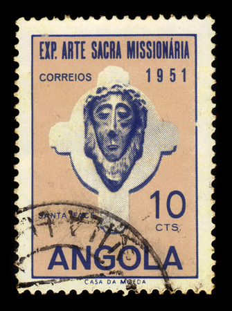 missionary: ANGOLA - CIRCA 1952: A stamp printed in Angola shows a head of Christ, exhibition of sacred missionary art issue, ochre, violet blue, circa 1952