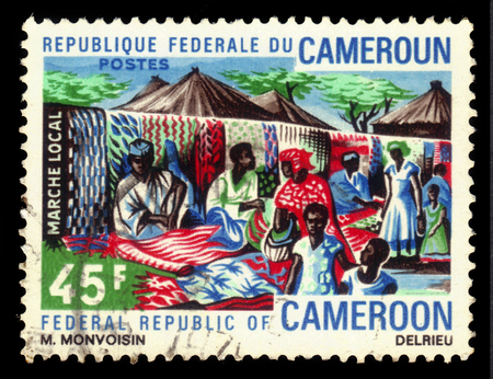 CAMEROON - CIRCA 1971: a stamp printed in Cameroon shows local market of carpets in the capital of Cameroon - Douala, circa 1971 Editorial