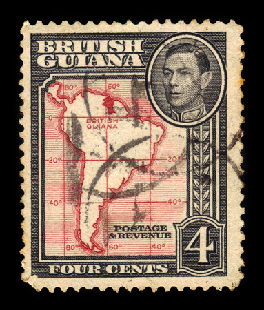 vi: BRITISH GUIANA - CIRCA 1938: a stamp printed in British Guiana shows outlines of South America and portrait King George VI, circa 1938 Editorial