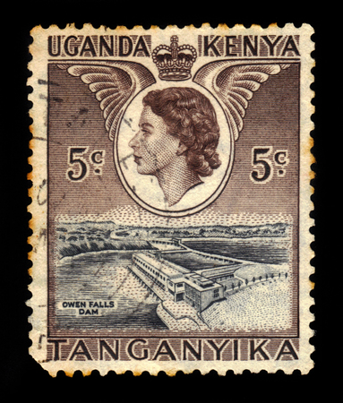 white nile: KENYA UGANDA TANGANYIKA - CIRCA 1954: A stamp printed in Kenya Uganda Tanganyika shows Owen falls dam and Queen Elizabeth II, circa 1954