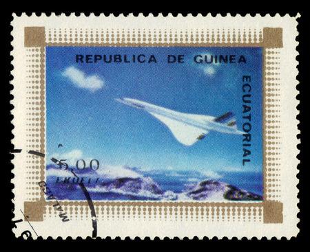 supersonic: Equatorial Guinea - circa 1976: A stamp printed in the Equatorial Guinea shows supersonic passenger jet airliner Concorde, circa 1976 Editorial