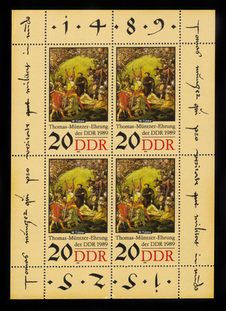 theologian: Germany - CIRCA 1989: postage stamp printed in Germany Democratic Republic (DDR) shows painting Muntzer in battle by Werner Tubke, 500th birthday of Thomas Muntzer, circa 1989 Editorial
