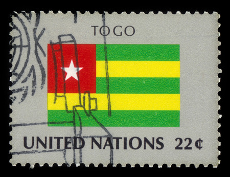 united nations: United Nations, New York - CIRCA 1986: a stamp printed in New York shows flag of Togo, flag series, circa 1986