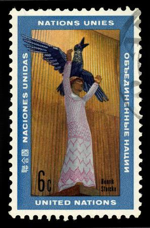 mankind: United Nations, Geneva - CIRCA 1969: a stamp printed in Geneva shows the happy future of mankind, sculpture by Henrik Starcke, circa 1969