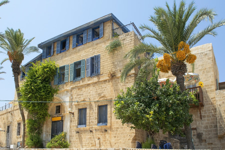 jaffo: TEL AVIV, ISRAEL - August 24, 2016: old stone house in mediterranean style, the time of the British mandate in Old Jaffa on august 24, 2016 Tel Aviv, Israel