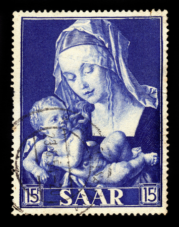 durer: Germany, Saarland - CIRCA 1954: a stamp printed in the Saar, Germany shows painting by Durer: Madonna with pear slice, circa 1954 Editorial